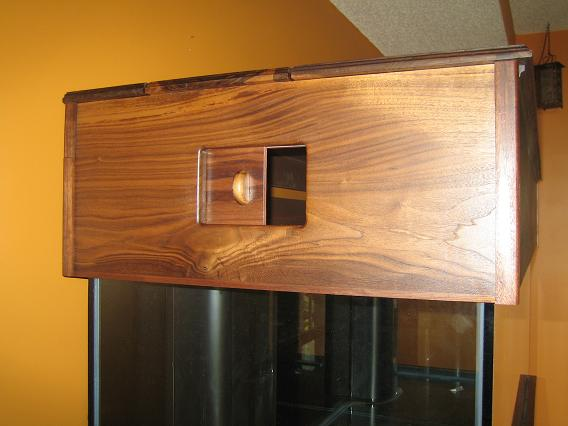 Custom cabinetry - canopy with sliding feeder door